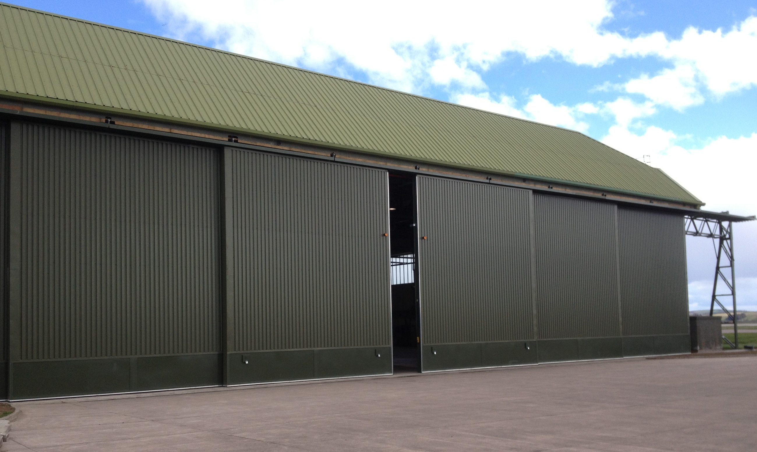 Alfa img showing gt glass hangar doors - It Now Undertakes Contracts Throughout The World For Governments Armed Forces And Private Companies Image Number 13 Of Aircraft Doors